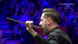 Mark Selby bites his cue in disbelief